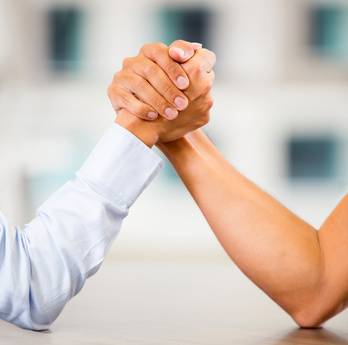 Business people arm wrestling at the office
